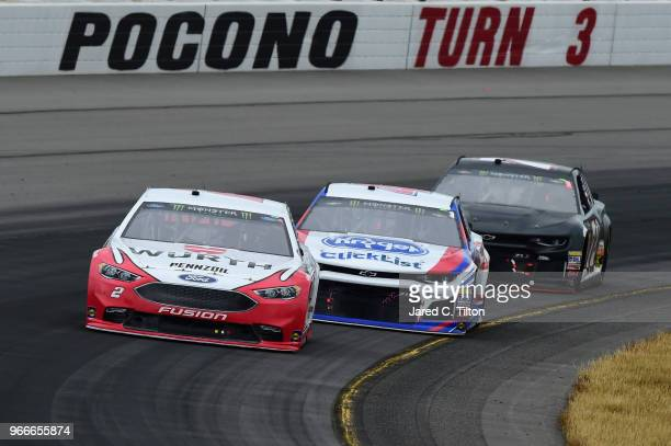 Brad Keselowski driver of the Wurth Ford leads AJ Allmendinger driver of the Kroger ClickList Chevrolet and Cole Whitt driver of the Chevrolet during...