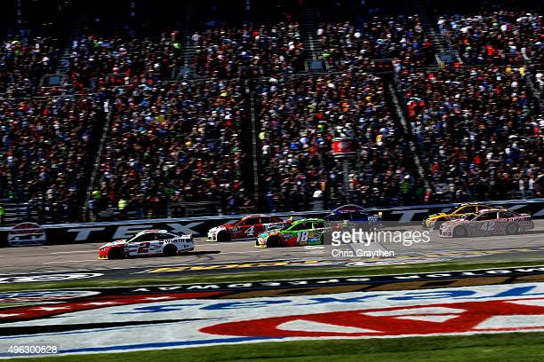 Brad Keselowski driver of the Wurth Ford leads the field past the green flag to start the NASCAR Sprint Cup Series AAA Texas 500 at Texas Motor...