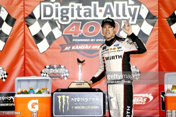 Brad Keselowski driver of the Wurth Ford poeses with the trophy in victory lane after winning the Monster Energy NASCAR Cup Series Digital Ally 400...