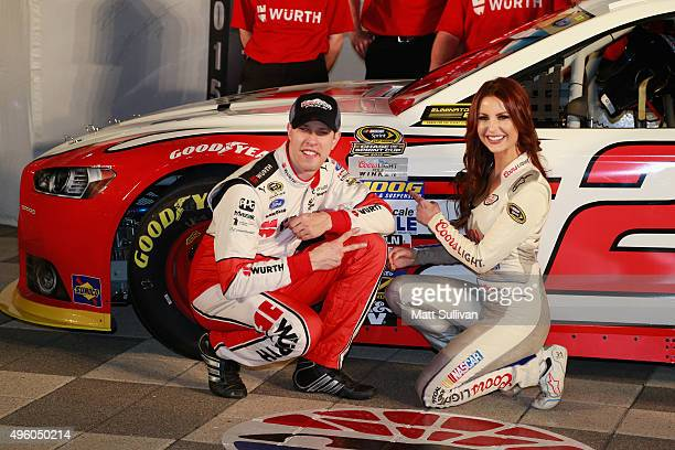 Brad Keselowski driver of the Wurth Ford poses with Miss Coors Light Amanda Mertz after qualifying for pole position during Service King qualifying...