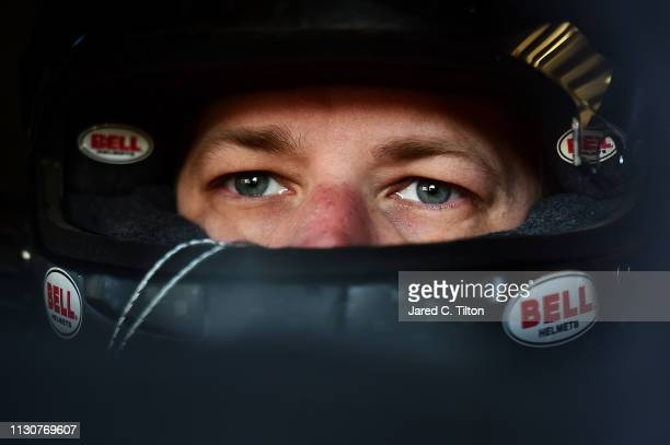 Brad Keselowski driver of the Wurth Ford sits in his car during practice for the Monster Energy NASCAR Cup Series Auto Club 400 at Auto Club Speedway...