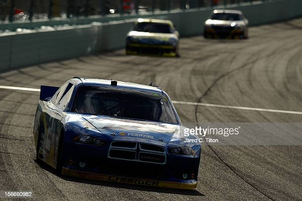 Brad Keselowski drives the Miller Lite Dodge during the NASCAR Sprint Cup Series Ford EcoBoost 400 at HomesteadMiami Speedway on November 18 2012 in...