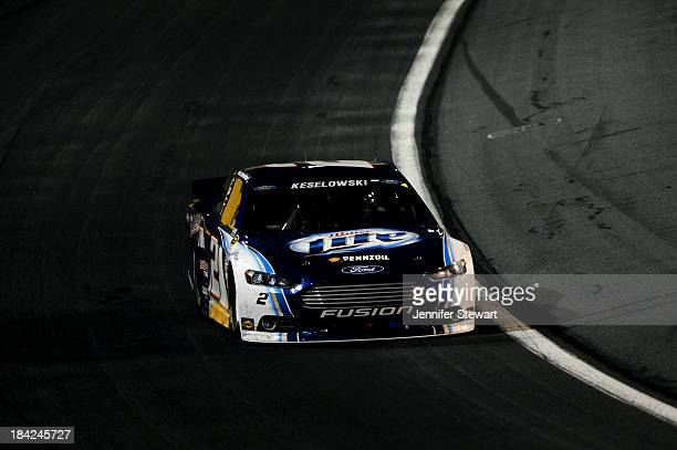 Brad Keselowski drives the Miller Lite Ford during the NASCAR Sprint Cup Series Bank of America 500 at Charlotte Motor Speedway on October 12 2013 in...