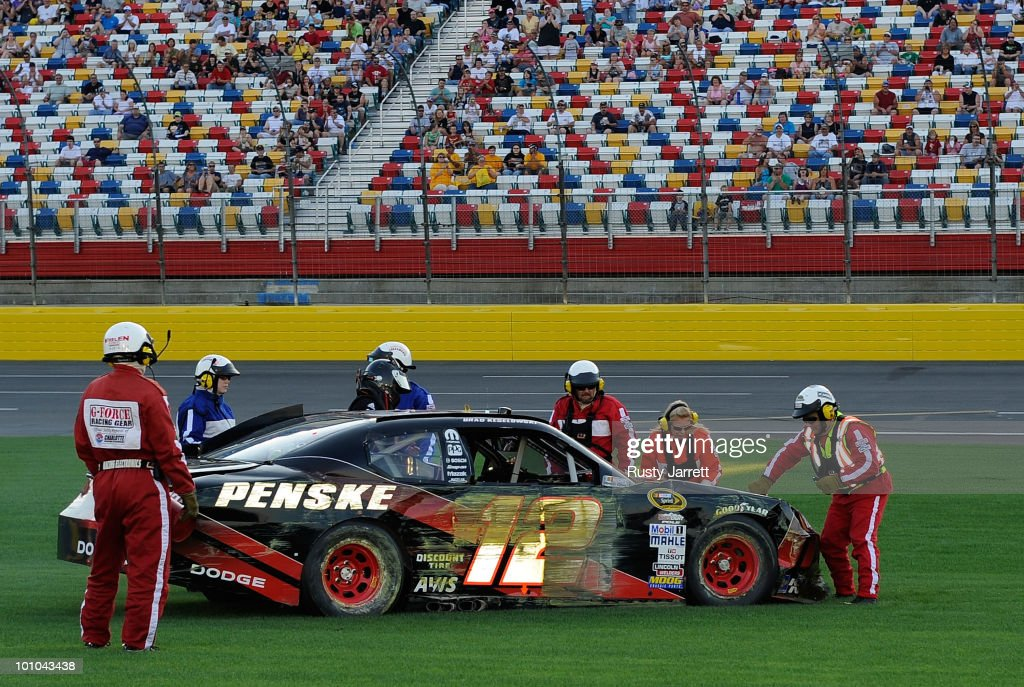 Brad Keselowski gets out of the wrecked #12 Penske Dodge on the tri-oval after losing control around turn 4 during qualifying for the NASCAR Sprint Cup Series Coca-Cola 600 at Charlotte Motor Speedway on May 27, 2010 in Concord, North Carolina.
