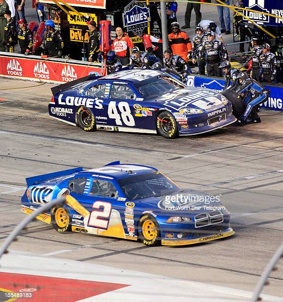 Brad Keselowski in the No 2 car cruises slowly past Jimmie Johnson in the No 48 car during the NASCAR Sprint Cup AAA Texas 500 at Texas Motor...