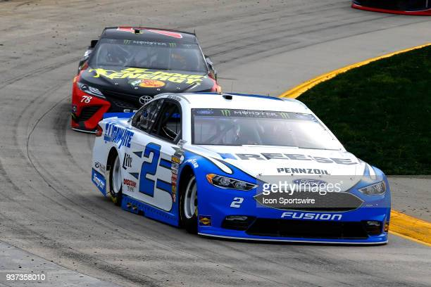 Brad Keselowski Team Penske Ford Fusion Reese/DrawTite leads Martin Truex Jr Furniture Row Racing Toyota Camry 5hour ENERGY/Bass Pro Shops through...