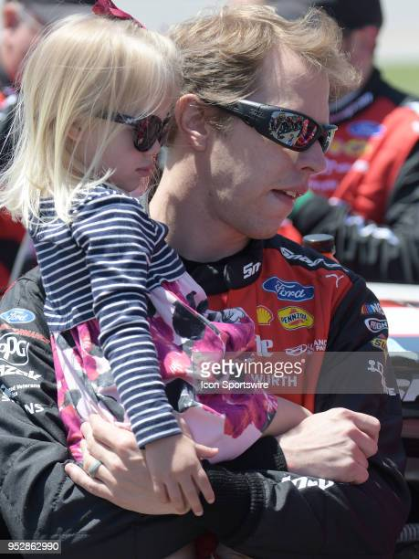 Brad Keselowski Team Penske Ford Fusion Snap On holds his daughter Scarlett before the Monster Energy Cup Series 49th Annual Geico 500 on April 29 at...