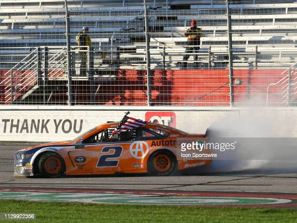 Brad Keselowski, Team Penske, Ford Mustang Autotrader performs a burnout after winning the Monster Energy Cup Series Folds of Honor QuikTrip 500 on...