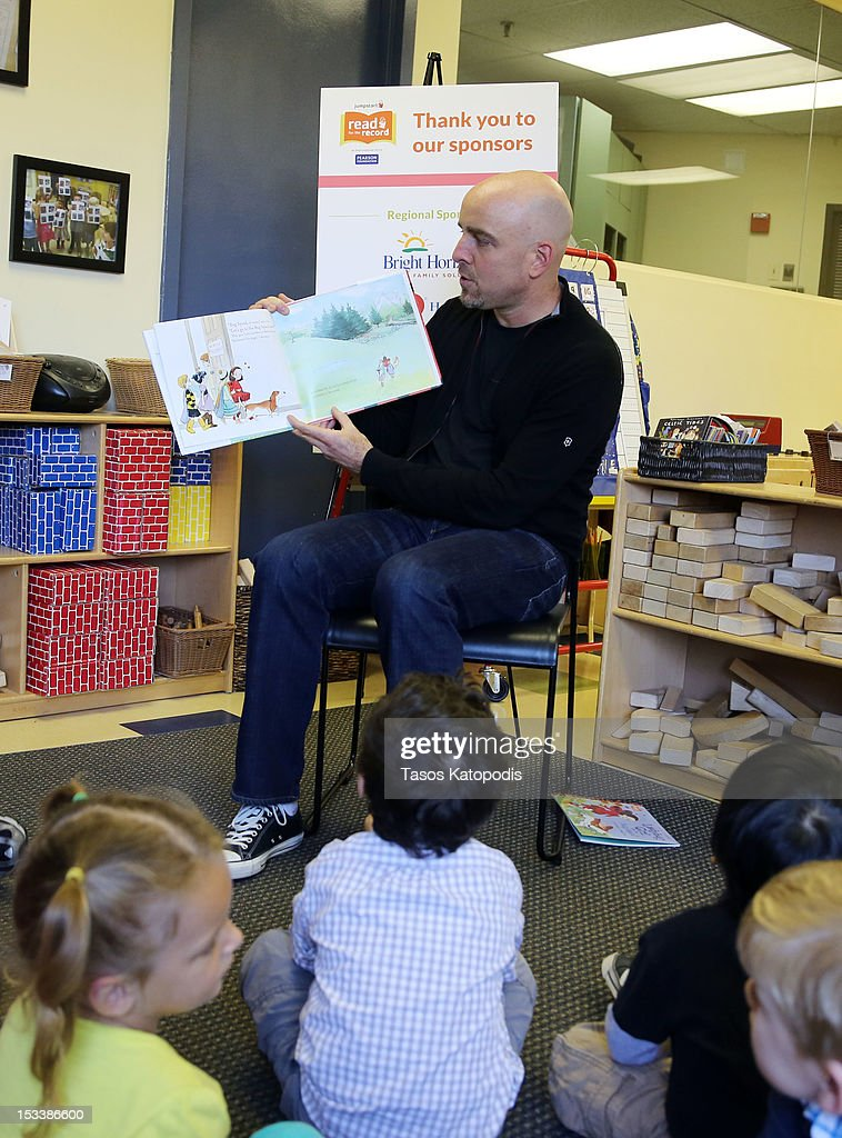 Brad Keywell co-founder and Director of Groupon reads to children at Bright Horizons on October 4, 2012 in Chicago, Illinois.