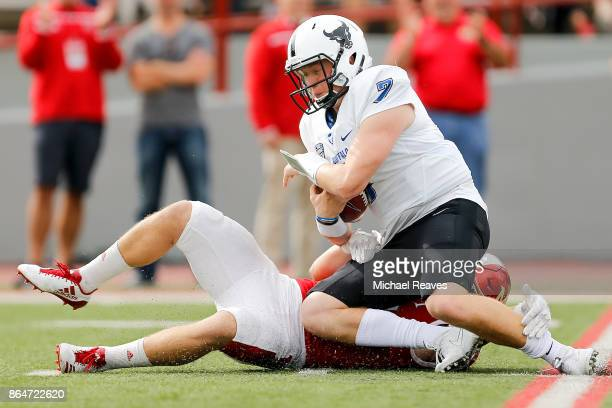 Brad Koenig of the Miami Ohio Redhawks sacks Kyle Vantrease of the Buffalo Bulls during the first half at Yager Stadium on October 21 2017 in Oxford...