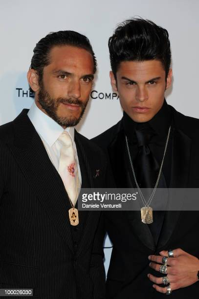 Brad Kroenig and Baptiste Giabiconi arrive at amfAR's Cinema Against AIDS 2010 benefit gala at the Hotel du Cap on May 20 2010 in Antibes France