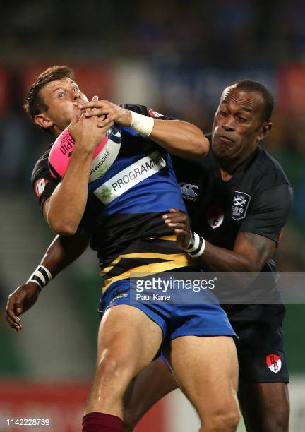Brad Lacey of the Force catches the ball against Sireli Bobo of the Dragons during the Rapid Rugby match between the Western Force and the Asia...