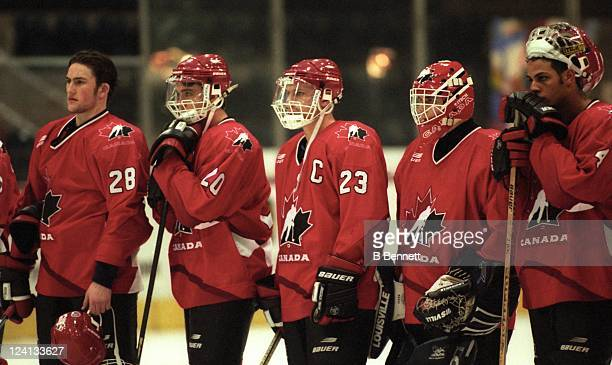 Brad Larsen of Team Canada stands with his teammates after they tied the Czech Republic in the 1997 World Junior Championships game on December 31...