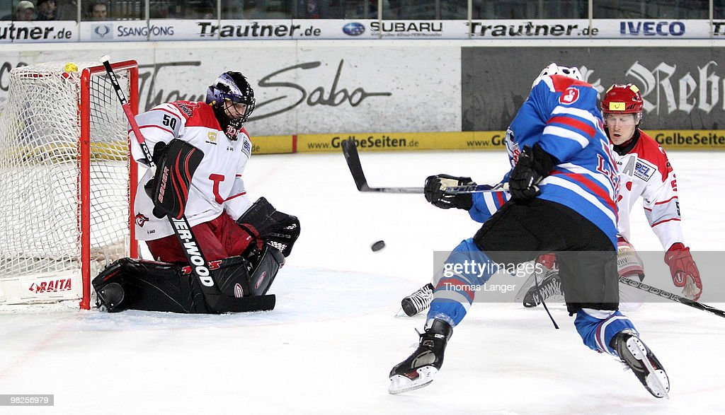 Brad Leeb scores his team's second goal against goalie Scott Travis of Hannover during the fourth DEL quarter final play-off game between Thomas Sabo Ice Tigers Nuremberg and Hannover Scorpions at the Arena Nuernberger Versicherung on April 05, 2010 in Nuremberg, Germany.