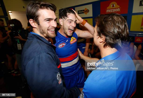 Brad Lynch Easton Wood and Luke Beveridge Senior Coach of the Bulldogs celebrate during the 2018 AFL round15 match between the Western Bulldogs and...