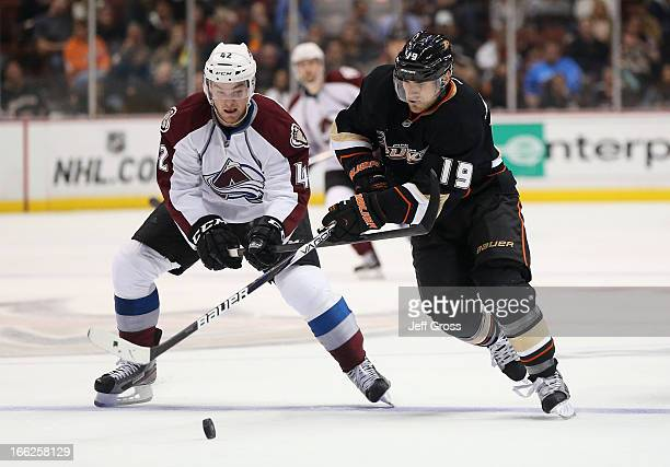 Brad Malone of the Colorado Avalanche and Matthew Lombardi of the Anaheim Ducks battle for the puck in the second period at Honda Center on April 10...