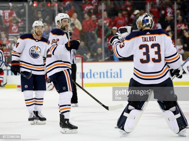 Brad MaloneEric Gryba and Cam Talbot of the Edmonton Oilers celebrate the 32 overtime win over the New Jersey Devils on November 9 2017 at Prudential...