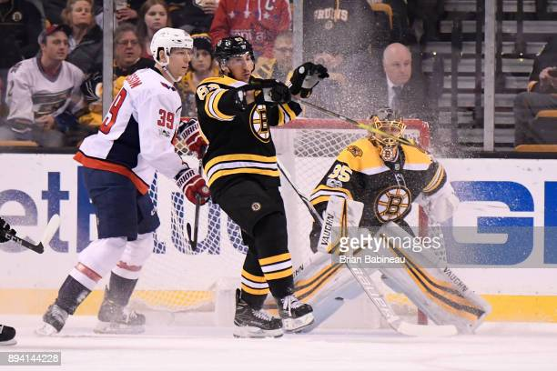 Brad Marchand and Anton Khudobin of the Boston Bruins watch the play against the Washington Capitals at the TD Garden on December 14 2017 in Boston...