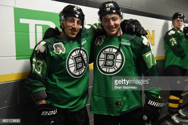 Brad Marchand and Frank Vatrano of the Boston Bruins pose for a photo while waiting to warm up before the game against the Philadelphia Flyers at the...