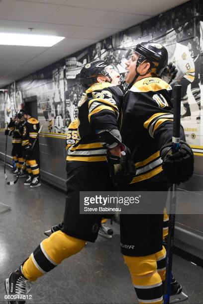 Brad Marchand and Jimmy Hayes of the Boston Bruins chest bump before warm ups against the Dallas Stars at the TD Garden on March 30 2017 in Boston...