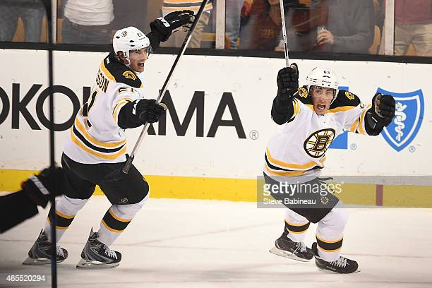 Brad Marchand and Loui Eriksson of the Boston Bruins celebrate a goal against the Philadelphia Flyers at the TD Garden on March 7 2015 in Boston...