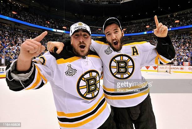 Brad Marchand and Patrice Bergeron of the Boston Bruins celebrate winning the Stanley Cup after defeating the Vancouver Canucks 40 in Game Seven of...