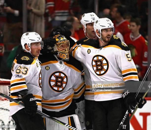 Brad Marchand Anton Khudobin Adam McQuaid and Zdeno Chara of the Boston Bruins celebrate a win over the Chicago Blackhawks at the United Center on...