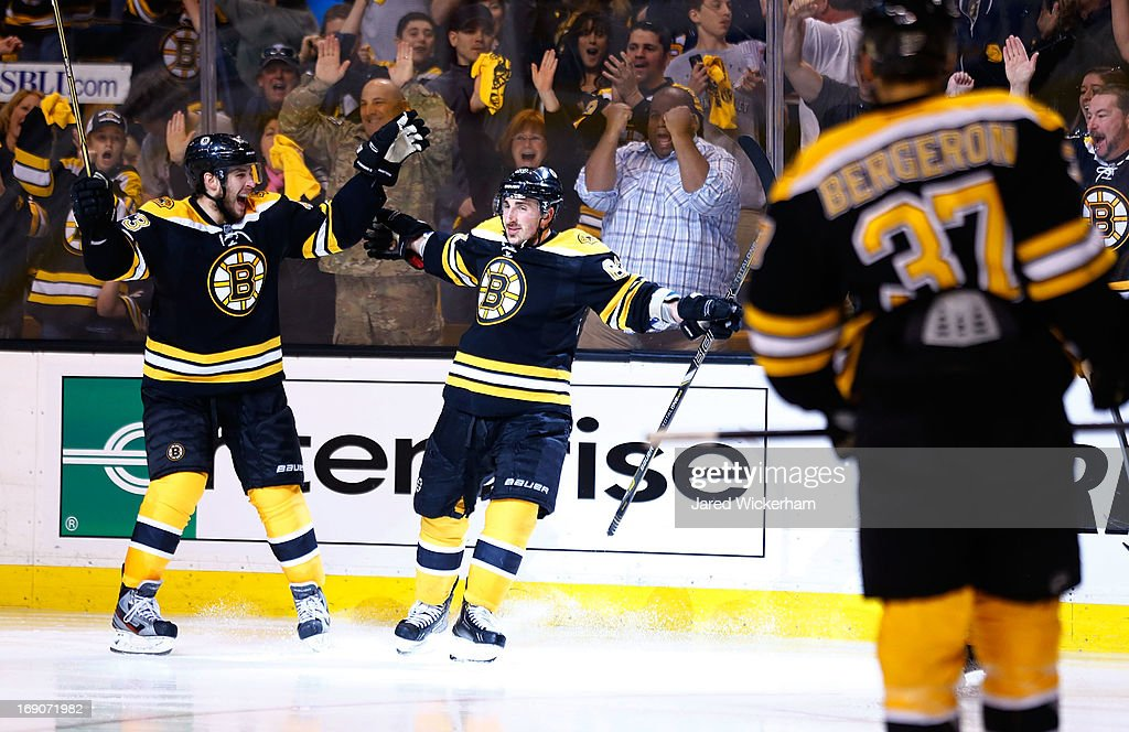 Brad Marchand #63 celebrates with teammate Matt Bartkowski #43 of the Boston Bruins after scoring a goal in the third period against the New York Rangers in Game Two of the Eastern Conference Semifinals during the 2013 NHL Stanley Cup Playoffs on May 19, 2013 at TD Garden in Boston, Massachusetts.