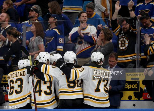 Brad Marchand Danton Heinen Marcus Johansson and Charlie McAvoy of the Boston Bruins celebrate after a goal during the third period of Game Six of...