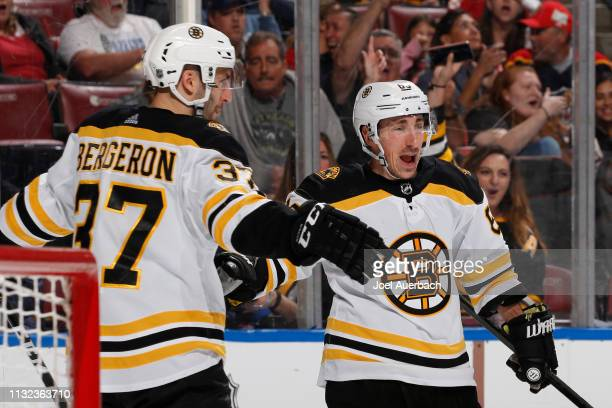 Brad Marchand is congratulated by Patrice Bergeron of the Boston Bruins after he scored a second period goal against the Florida Panthers at the BBT...
