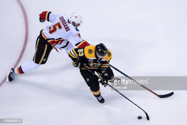 Brad Marchand of Boston Bruins and Mark Giordano of Calgary Flames in action during 2018 ORG NHL China Games Boston Bruins and Calgary Flames on...