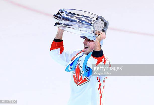 Brad Marchand of Team Canada lifts the World Cup Trophy after scoring the winning goal in Game Two of the World Cup of Hockey final series against...