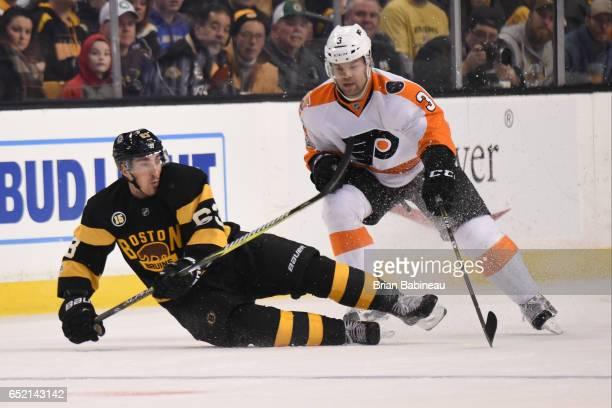 Brad Marchand of the Boston Bruins against Radko Gudas of the Philadelphia Flyers at the TD Garden on March 11 2017 in Boston Massachusetts