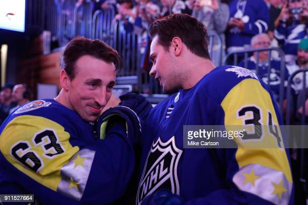 Brad Marchand of the Boston Bruins and Auston Matthews of the Toronto Maple Leafs talk before being introduced during the 2018 Honda NHL AllStar Game...