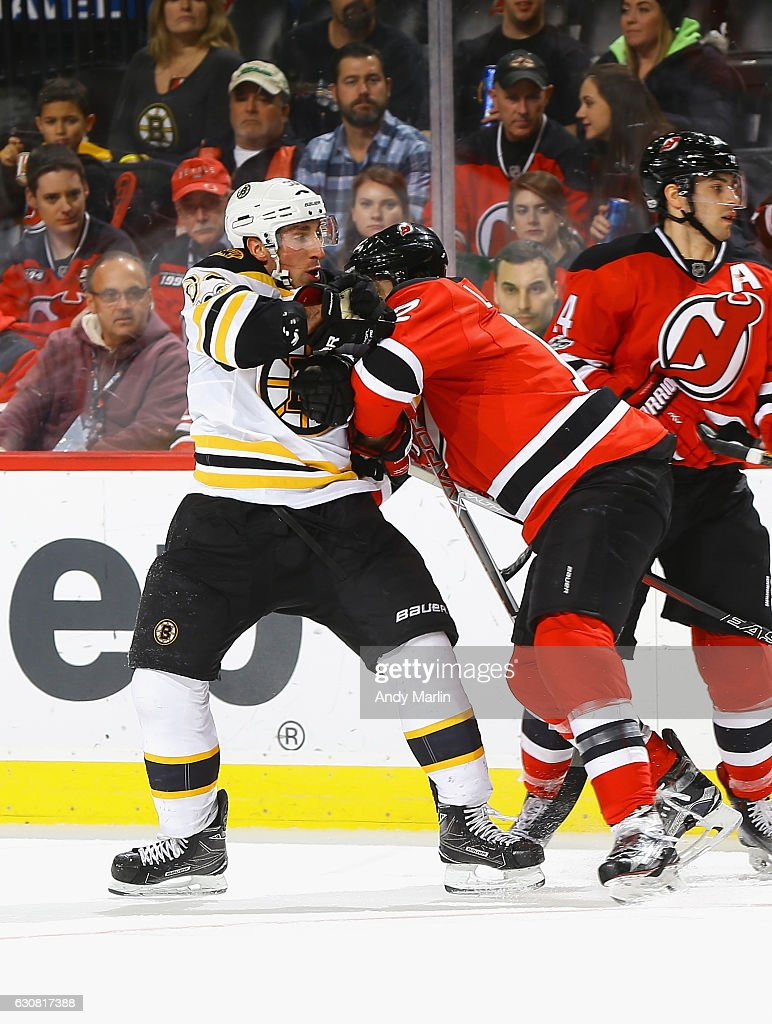 Brad Marchand #63 of the Boston Bruins and Ben Lovejoy #12 of the New Jersey Devils come together during the game at Prudential Center on January 2, 2017 in Newark, New Jersey.