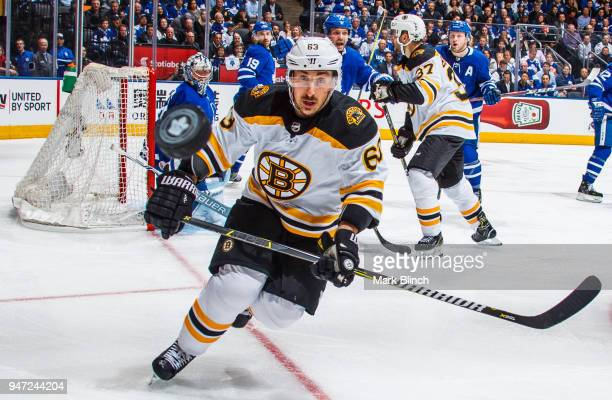 Brad Marchand of the Boston Bruins and Frederik Andersen of the Toronto Maple Leafs follow the puck in Game Three of the Eastern Conference First...