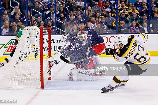 Brad Marchand of the Boston Bruins beats Sergei Bobrovsky of the Columbus Blue Jackets for the gamewinning goal during the third period on October 13...
