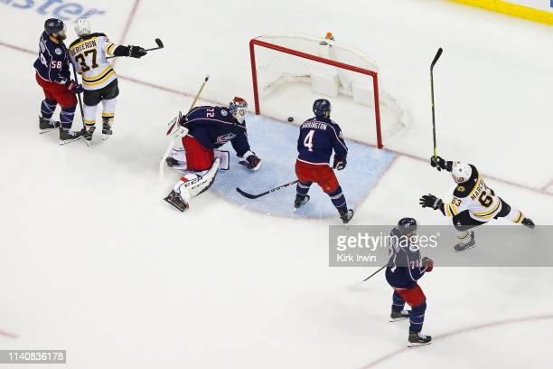 Brad Marchand of the Boston Bruins celebrates after Patrice Bergeron beats Sergei Bobrovsky of the Columbus Blue Jackets for a goal during the third...
