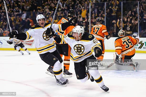 Brad Marchand of the Boston Bruins celebrates after scoring a goal against the Philadelphia Flyers during the third period sending the game into...
