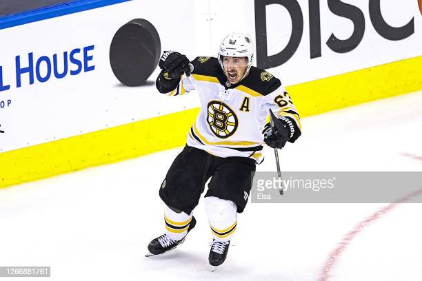 Brad Marchand of the Boston Bruins celebrates after scoring the go-ahead goal at 11:40 against the Carolina Hurricanes during the third period in...