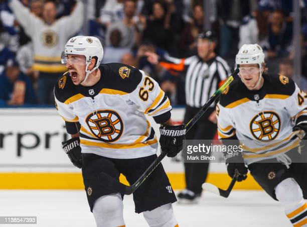Brad Marchand of the Boston Bruins celebrates his empty net goal against the Toronto Maple Leafs during the third period during Game Six of the...