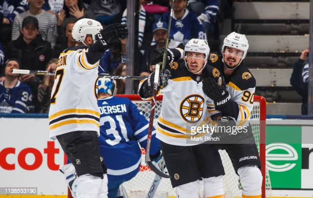 Brad Marchand of the Boston Bruins celebrates his goal against the Toronto Maple Leafs with teammates Marcus Johansson and Patrice Bergeron during...