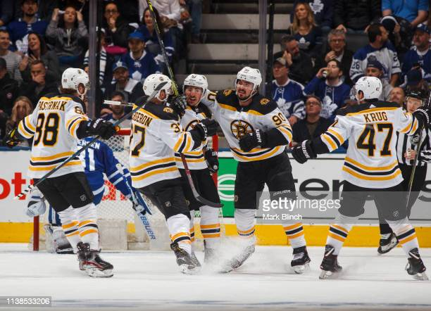 Brad Marchand of the Boston Bruins celebrates his goal against the Toronto Maple Leafs with teammates Marcus Johansson David Pastrnak Torey Krug and...
