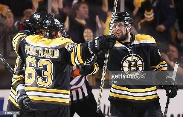 Brad Marchand of the Boston Bruins celebrates his second period goal against the Tampa Bay Lightning with teammates in Game Five of the Eastern...