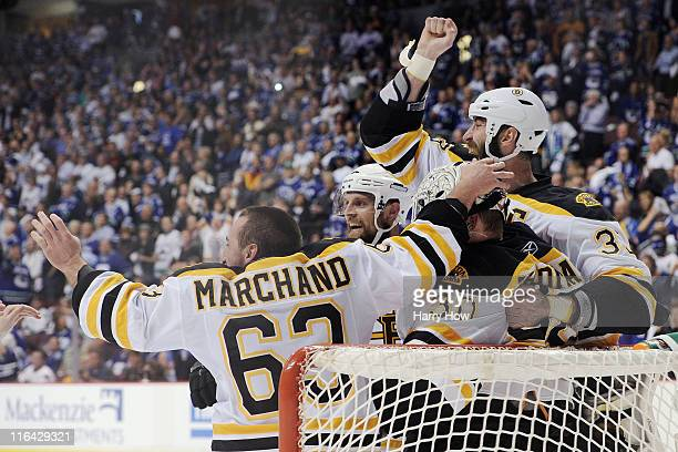 Brad Marchand of the Boston Bruins celebrates with his teammates Tim Thomas and Zdeno Chara after defeating the Vancouver Canucks in Game Seven of...