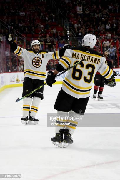 Brad Marchand of the Boston Bruins celebrates with Patrice Bergeron after scoring a goal on the Carolina Hurricanes during the third period in Game...