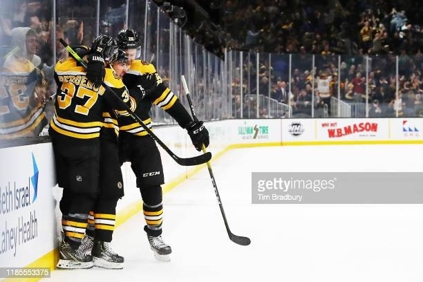 Brad Marchand of the Boston Bruins celebrates with teammates after scoring the goahead goal during the third period against the Pittsburgh Penguins...
