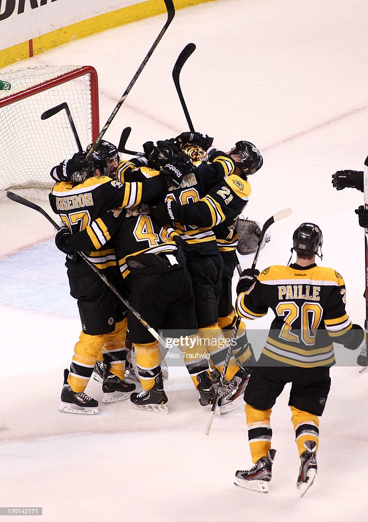 Brad Marchand #63 of the Boston Bruins celebrates with teammates after defeating the Pittsburgh Penguins 1-0 in Game Four of the Eastern Conference Final during the 2013 Stanley Cup Playoffs at TD Garden on June 7, 2013 in Boston, Massachusetts.