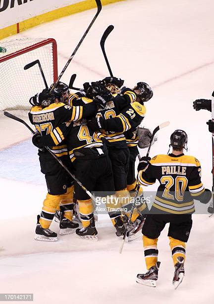 Brad Marchand of the Boston Bruins celebrates with teammates after defeating the Pittsburgh Penguins 1-0 in Game Four of the Eastern Conference Final...