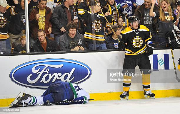 Brad Marchand of the Boston Bruins checks against Sami Salo of the Vancouver Canucks at the TD Garden on January 7 2012 in Boston Massachusetts